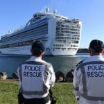 NSW Police Rescue officers look on as the Ruby Princess, with crew only onboard, docks at Port Kembla, Wollongong, Friday, January 1, 2016. A criminal investigation will be launched into how cruise line operator Carnival Australia was allowed to disembark Ruby Princess passengers in Sydney, resulting in several deaths and COVID-19 outbreaks throughout the country. (AAP Image/Dean Lewins) NO ARCHIVING