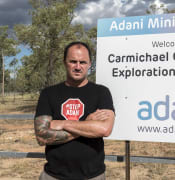 Jeremy Buckingham with Adani mine site sign