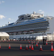 The quarantined cruise ship Diamond Princess is anchored at the Yokohama Port in Yokohama, near Tokyo, Tuesday, Feb. 18, 2020. The cruise ship will begin letting passengers off the boat on Wednesday after it's been in quarantined for 14 days. (AP Photo/Koji Sasahara)