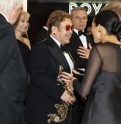 Duke_and_Duchess_of_Sussex_speak_with_Elton_John.jpg