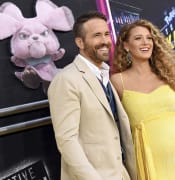Actor Ryan Reynolds, left, is joined by his pregnant wife, actress Blake Lively at the premiere of