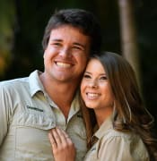 Bindi Irwin and her partner Chandler Powell pose for a photo during an event to celebrate Bindi