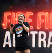 Celeste Barber speaks during the Fire Fight Australia bushfire relief concert at ANZ Stadium in Sydney, Sunday, February 16, 2020. (AAP Image/Joel Carrett) NO ARCHIVING