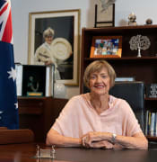 Margaret Court poses for a portrait in her office with a photograph of her after winning Wimbledon in 1965 in Perth, Friday, January 22, 2021. Controversial tennis champion Margaret Court is one of four appointments as Companion (AC) of the Order of Australia in this year