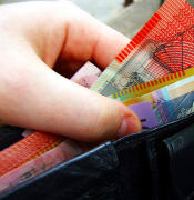 Money in wallet By Martin Kingsley from Melbourne Australia Cashmoney CC BY 2.0
