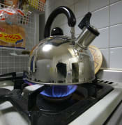 Kettle boiling on gas stove (385314458).jpg