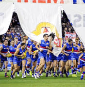 Western Bulldogs running through the banner