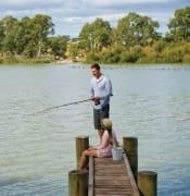 Couple fishing on jetty