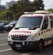 800px-Ambulance_Victoria_Mercedes_014_paramedic_at_St_Kilda_Junction_2013.jpg