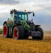 green-tractor-plowing-the-fields-on-focus-photography-2933243.jpg