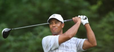 Tiger Woods drives by Allison
