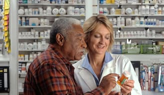 768px Man consults with pharmacist
