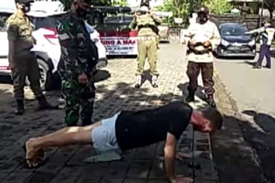 foreigners forced to do pushups in bali