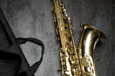 brass-saxophone-on-gray-table-near-black-bag-164936.jpg