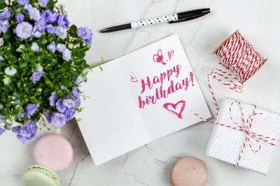 happy-birthday-card-beside-flower-thread-box-and-macaroons-2072181.jpg