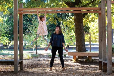 Child_and_Mum_on_swing_community_vision_image_MASC.jpg