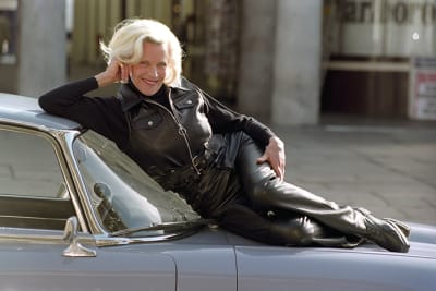 File photo dated 25/04/94 of Honor Blackman on an E-Type Jaguar whilst attending the re-launch of Spangles in central London. James Bond star Honor Blackman has died at the age of 94, her family has said.. Issue date: Monday April 6, 2020. The actress found international stardom as Pussy Galore at the age of 38, alongside Sean Connery, in 1964