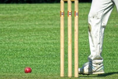 800px Cricket ball and wicket at Takeley Cricket Club ground Essex England 02