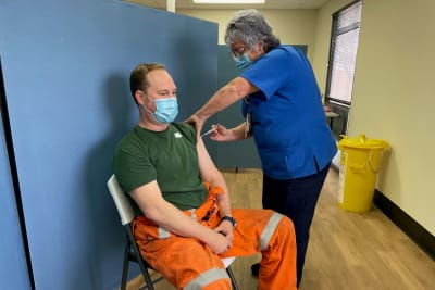 Photo 2 Jack DArcy receives the COVID 19 vaccine at BHPs Olympic Dam on site clinic edited