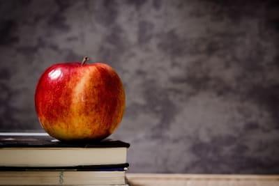 red apple on a teachers desk from pxfuel dot com