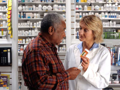 17337 a man consulting his pharmacist pv
