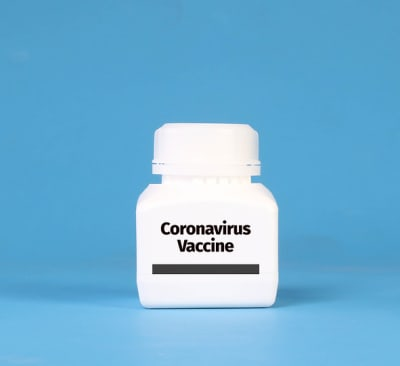 White bottle with Coronavirus Vaccine text on blue background