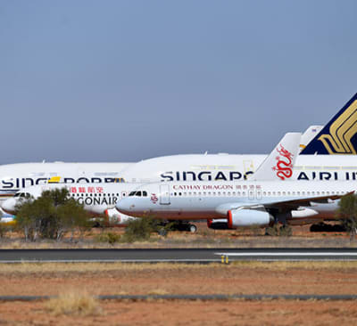Grounded commercial aircraft due to the Coronavirus (COVID-19) pandemic are seen parked at the Asia Pacific Aircraft Storage facility in Alice Springs, Sunday, August 30, 2020. Aircraft including the Airbus A380s and  Boeing MAX 8s are being stored at the Alice Springs facility because central Australia
