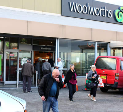 Shoppers are seen outside a Woolworths in Marrickville in Sydney, Tuesday, March 17, 2020. A dedicated shopping hour is underway for seniors and pension card holders who