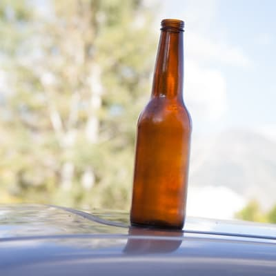 Beer Bottle on Car Roof