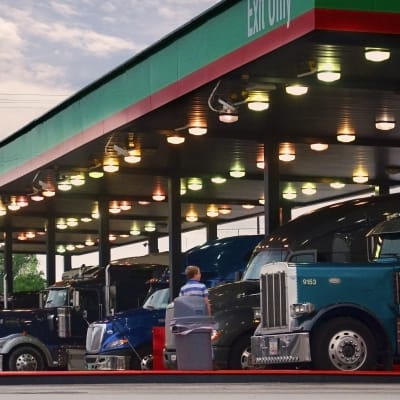 Boy at truck stop fuel island 08-132-2014 022