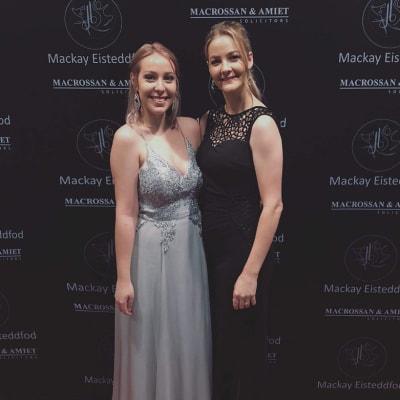 Nicole (left) & Michaela Black & Silver Dresses
