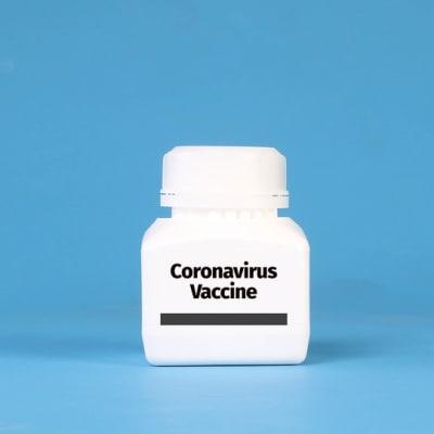 White bottle with Coronavirus Vaccine text on blue background