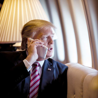 President Donald Trump talks on the phone aboard Air Force One during a flight to Philadelphia, Pennsylvania, to address a joint gathering of House and Senate Republicans, Thursday, January 26, 2017. This was the President's first Trip aboard Air Force One. (Official White House Photo by Shealah Craighead)