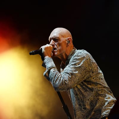 epa06093532 Australian musician Peter Garrett, lead singer of the band Midnight Oil performs during Les Vieilles Charrues Festival in Carhaix, France, 16 July 2017. The music festival ran from 13 to 16 July.  EPA/HUGO MARIE
