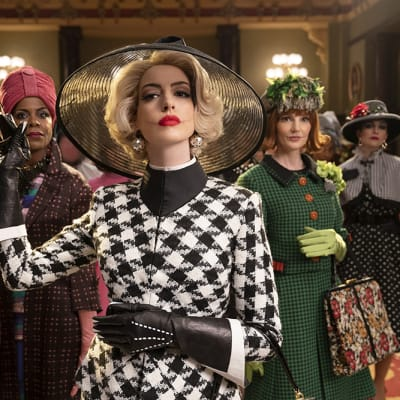 This image released by Warner Bros. Entertainment shows Anne Hathaway, center, in a scene from