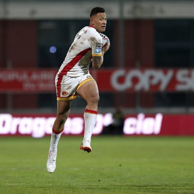 Catalans Dragons Israel Folau runs with the ball during the Super League rugby match between Catalans Dragons and Castleford Tigers at Stade Gilbert Brutus in Perpignan, France, Saturday, Feb. 15, 2020. (AP Photo/Joan Monfort)