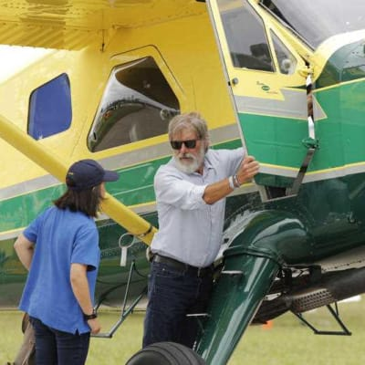 Harrison Ford opens the door on his plane for Jodie Gawthorp, of Westchester, Ill.jpg