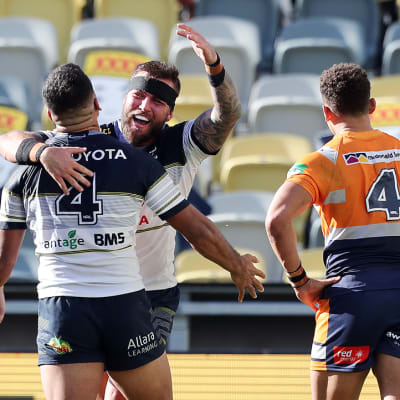 Kyle Feldt of the Cowboys celebrates scoring a try during the Round 7 NRL match between the North Queensland Cowboys and the Newcastle Knights at QLD Country Bank Stadium in Townsville, Saturday, June 27, 2020. (AAP Image/Cameron Laird) NO ARCHIVING, EDITORIAL USE ONLY
