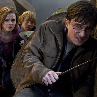 FILE-   In this file film publicity image released by Warner Bros. Pictures, from left, Emma Watson, Rupert Grint and Daniel Radcliffe are shown in a scene from