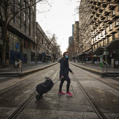 A general view of empty streets at Bourke Street in Melbourne, Sunday, July 12, 2020. Premier Daniel Andrews has issued a plea to all Victorians to follow the latest lockdown rules, as the state recorded 273 new cases and another death. (AAP Image/Daniel Pockett) NO ARCHIVING