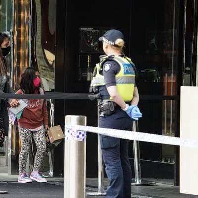 Recently arrived overseas travellers get off their bus and wait to check in at the Crown Promenade Hotel in Melbourne, Sunday, March 29, 2020. Travellers who arrive into the country today from overseas are being sent straight to makeshift quarantine facilities across Australia. Travellers will spend 14 days of quarantine in state-funded hotel rooms, with doors guarded by state police, defence personnel or private security guards.A shutdown of non-essential services is in effect Australia wide in a bid to slow the spread of the coronavirus (COVID-19) disease. (AAP Image/Scott Barbour) NO ARCHIVING