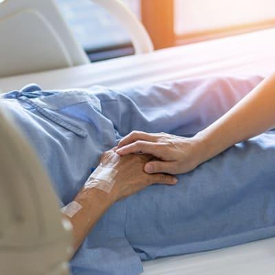 bigstock Caregiver Holding Elderly Seni 322215883