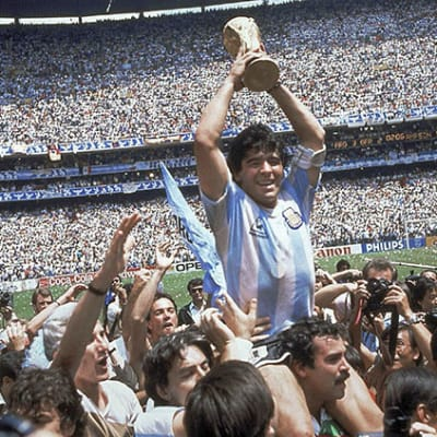 FILE - In this June 29, 1986 file photo, Diego Maradona holds up his team