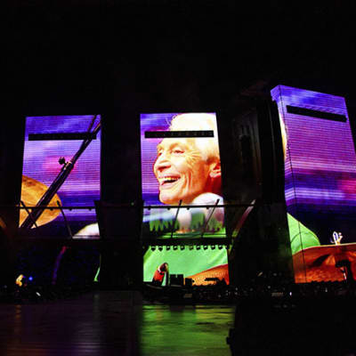 A video tribute to Charlie Watts plays before the Rolling Stones perform during the
