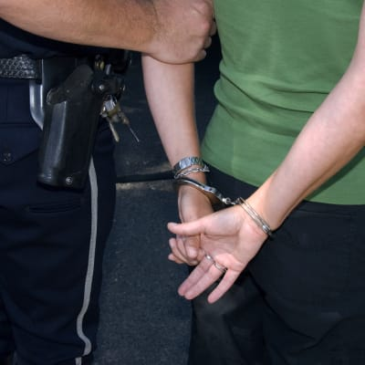 Demo_arrest_handcuffed.jpg
