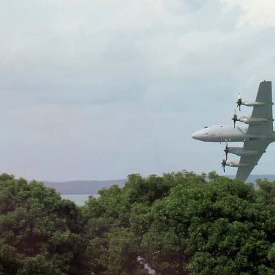 RAAF P3 Orion on a low level flypast of the Darwin Cenotaph.jpg