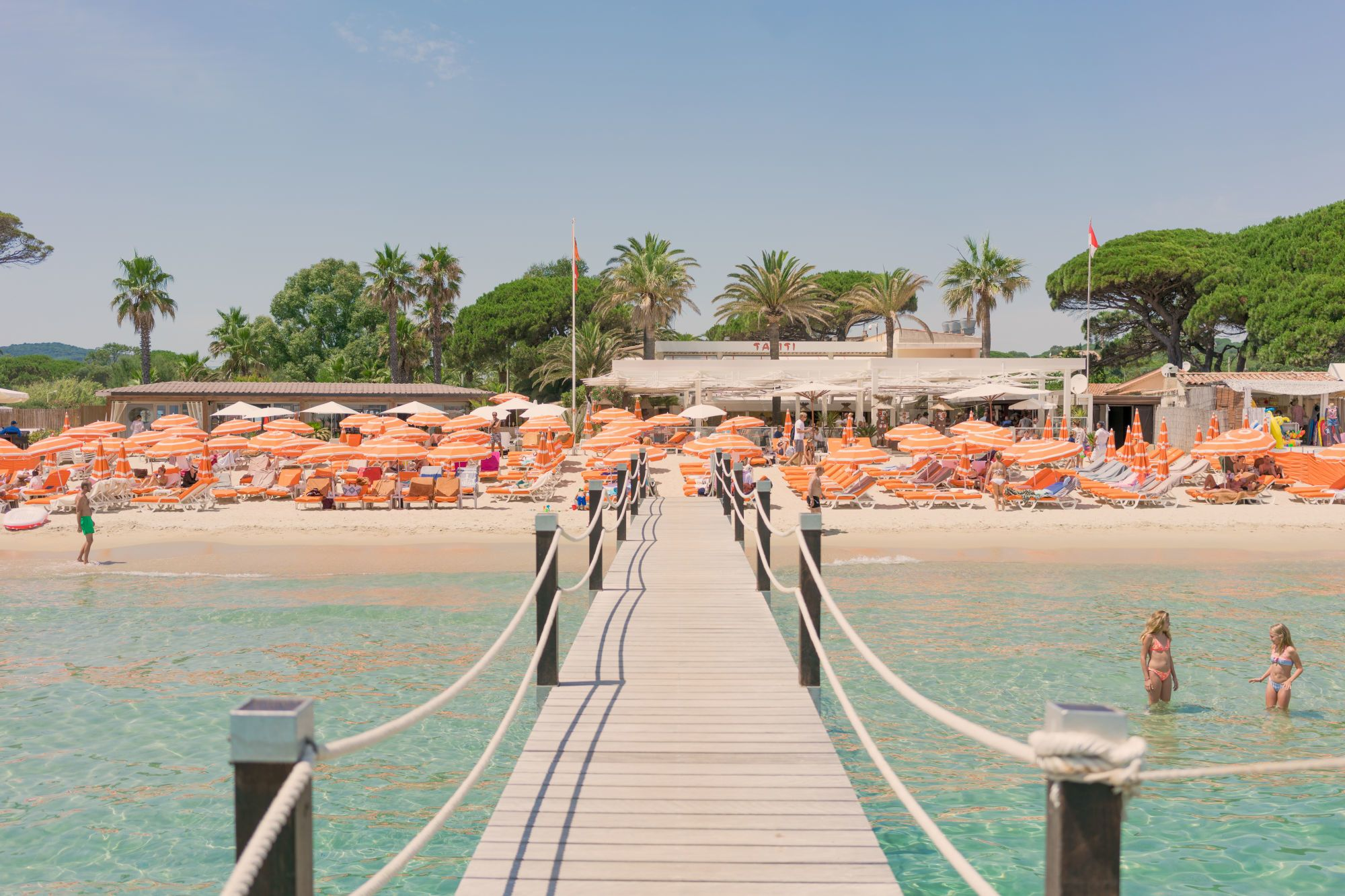 Adorned with bright orange and white-striped umbrellas and a private dock,  this is where your adventure will begin. Enjoy the people watching as  guests ... b19bd5ab0ef