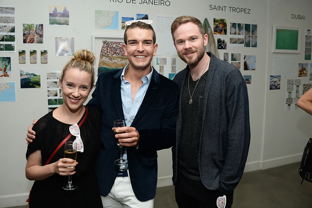 Dana Ashmore, photographer Gray Malin, and actor Shawn Ashmore attend the launch of Gray Malin's new book BEACHES at Eric Buterbaugh Floral on May 10, 2016 in West Hollywood, California. (Photo by Matt Winkelmeyer/Getty Images for Bollare)