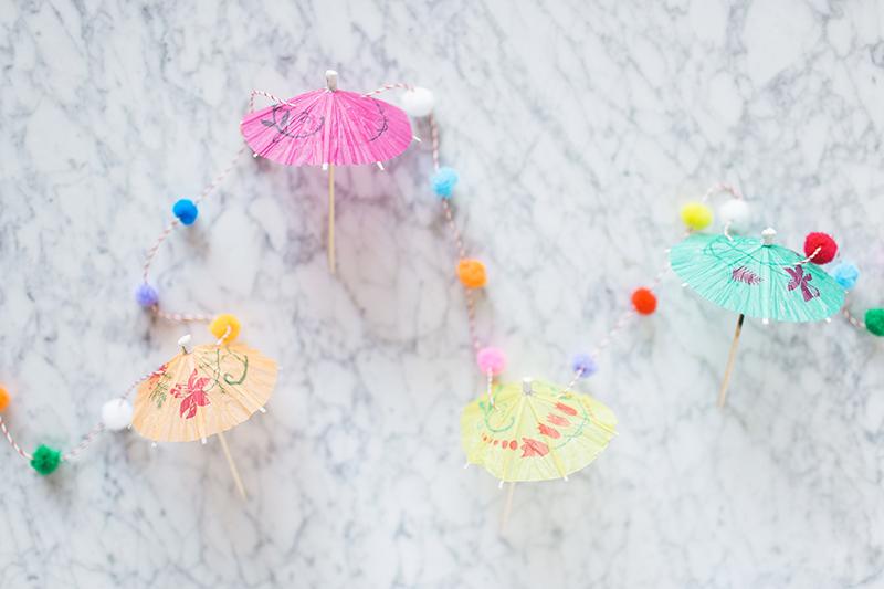 Gray Malin's umbrella pom pom garland