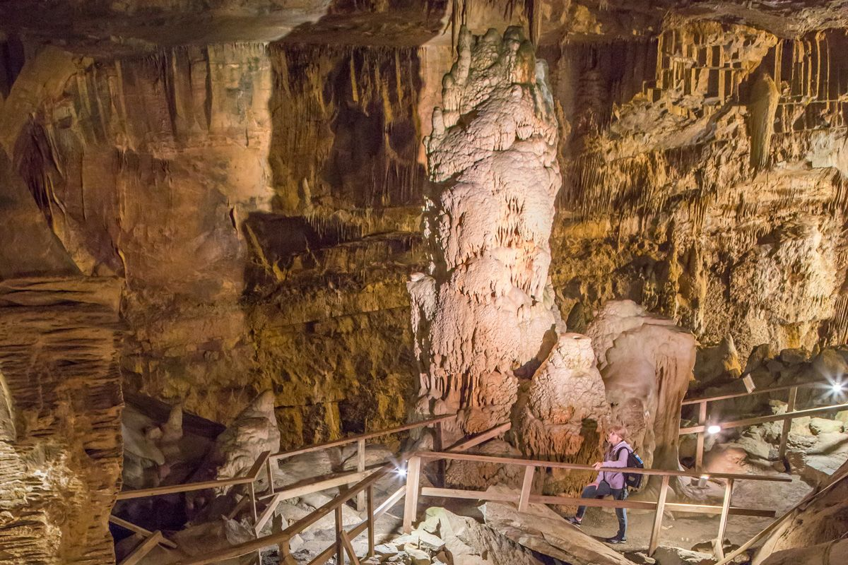 a person taking a tour of the lost world caverns in lewisburg, wv